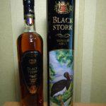 фото бутылки коньяка черный аист