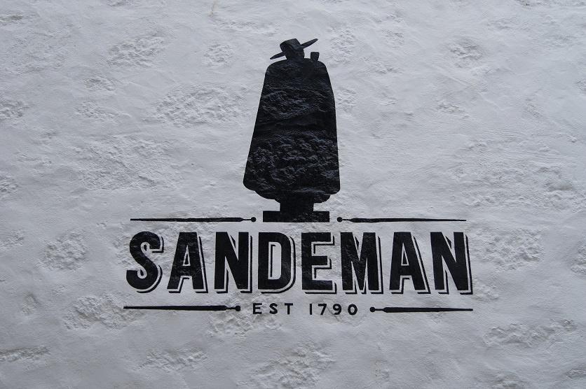 логотип Сандеман